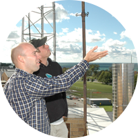 Professor Steiger and student analyzing weather patterns
