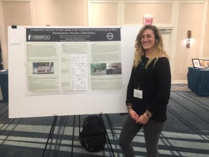 Student Abigail Jago presenting poster at a conference