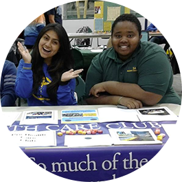 Two students sitting at a table during Student Involvement Day