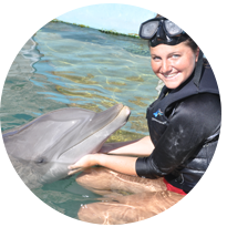 Zoology intern with dolphin