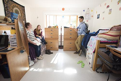 Students talking in residence hall room