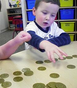 Child playing with coins