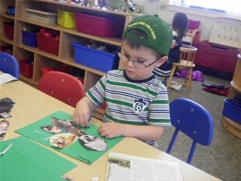Child gluing paper