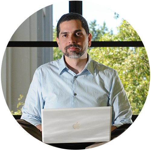 Professor Ulises Mejias with laptop in Lanigan Hall