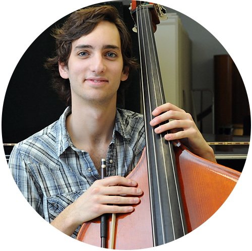 A music student poses with his bass