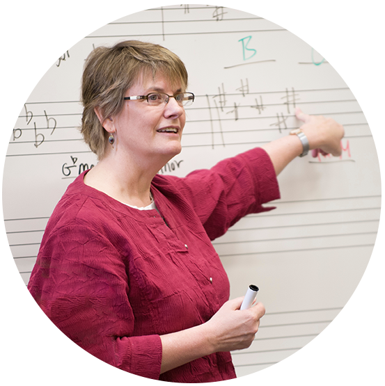 Dean Julie Pretzat teaching music class