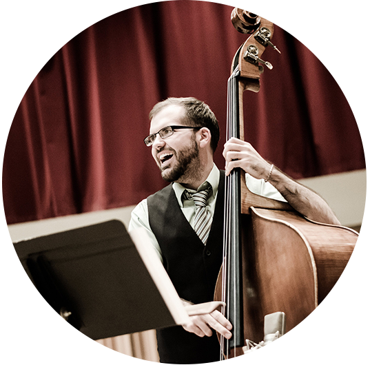Adjunct Faculty member Danny Ziemann playing upright bass