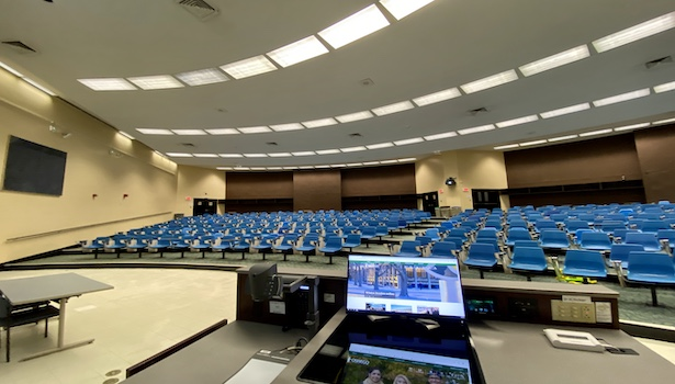 Photo from the podium showing the front/left of the classroom. Including seats and monitors.