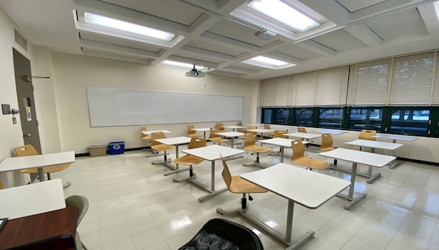 Photo shows the classroom from the podium perspective including chairs and projector.
