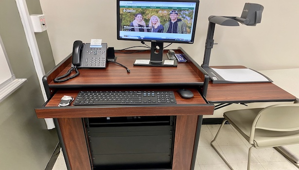 Photo showing the podium in this room including the PC, Doc cam and laptop connection.