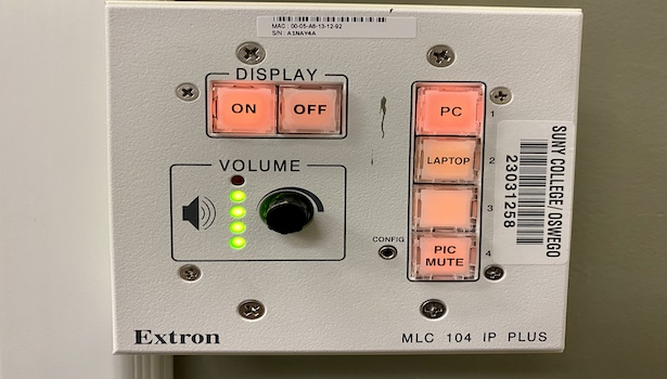 Photo shows the extron panel in this room.