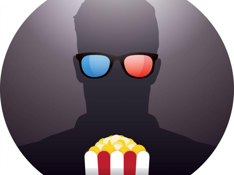Person with 3d glasses and popcorn watching a film