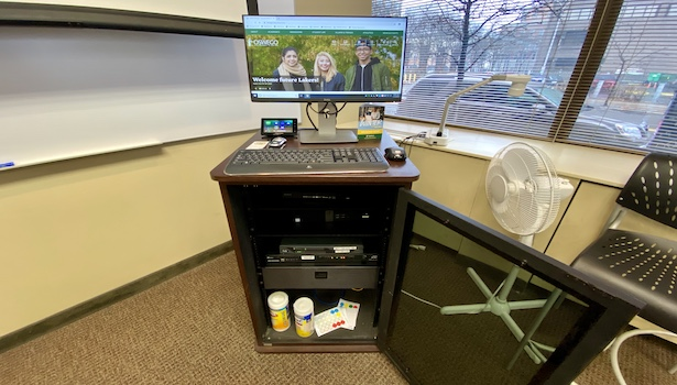 Photo of the podium in the classroom with the PC, Touch Panel and wireless KB/M