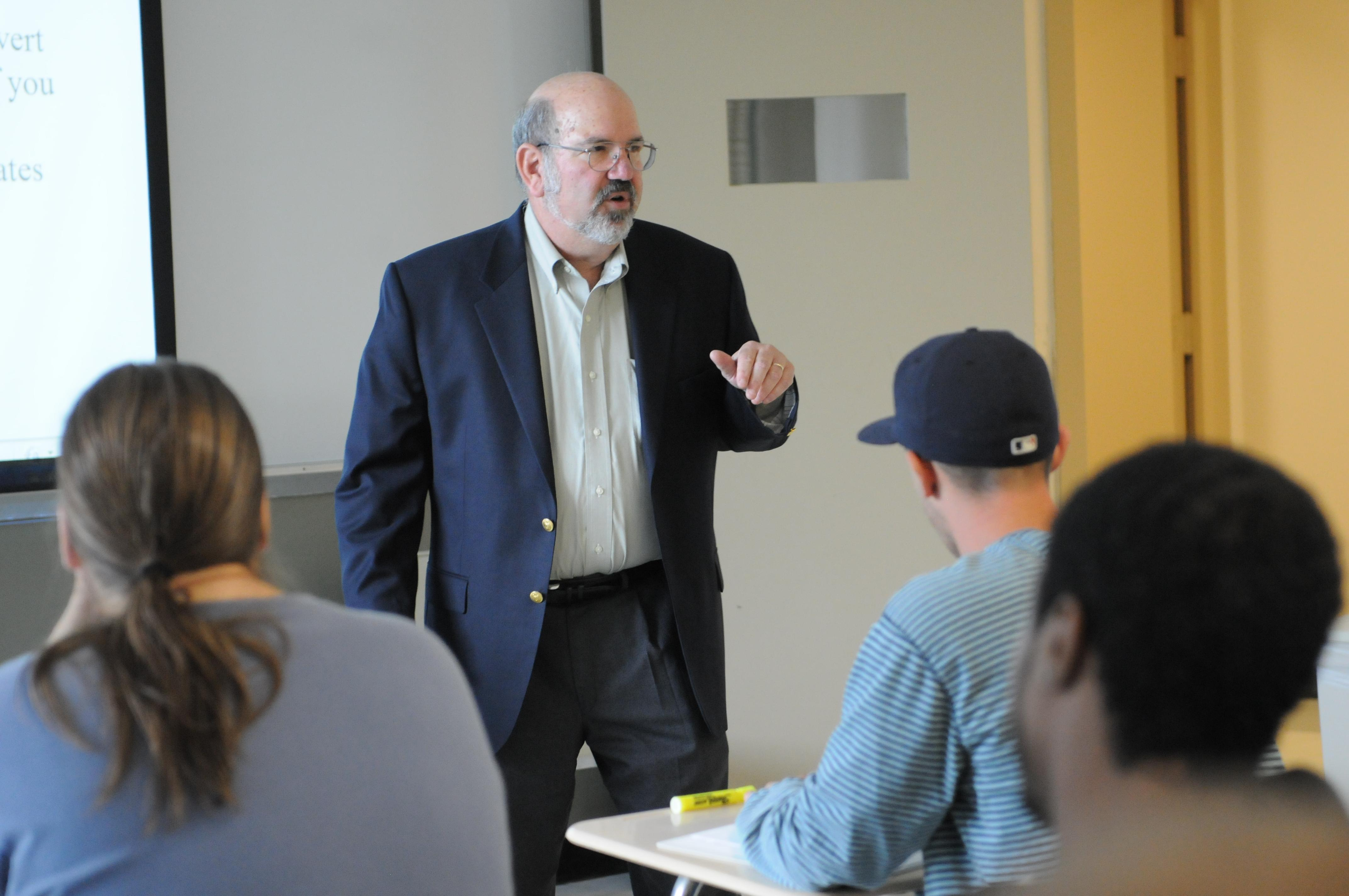 Professor Lawrence Spizman lecturing in a classroom