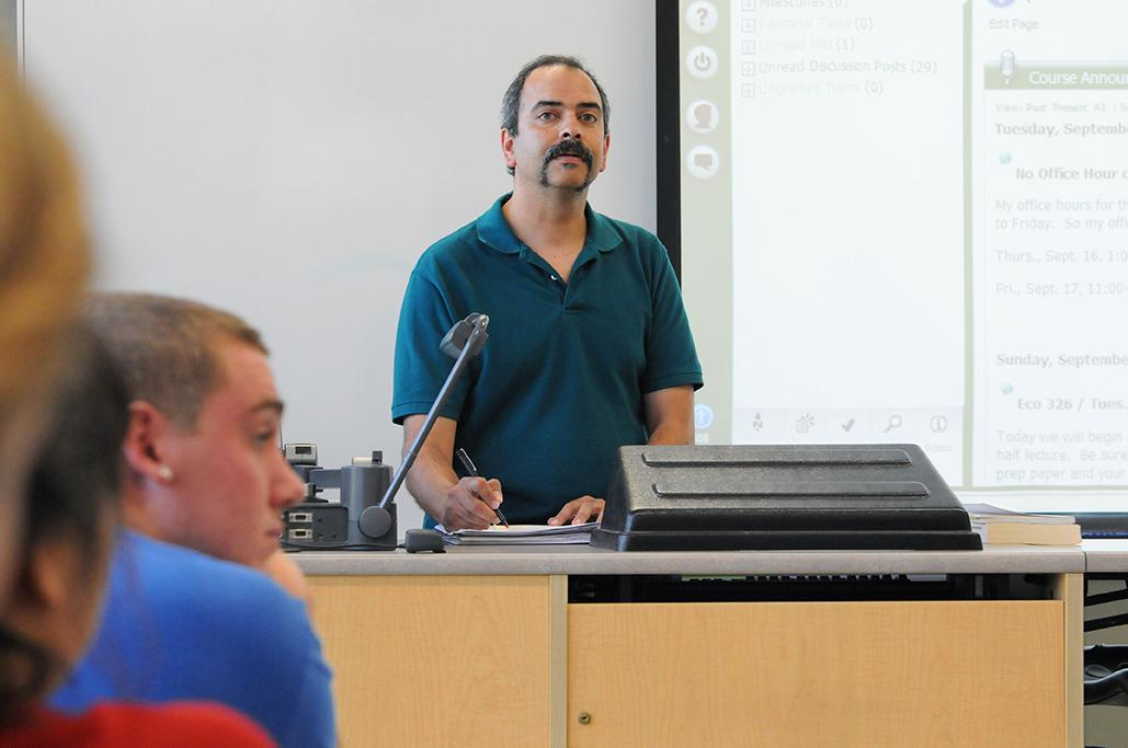 Professor Ranjit Dighe lectures in front of class