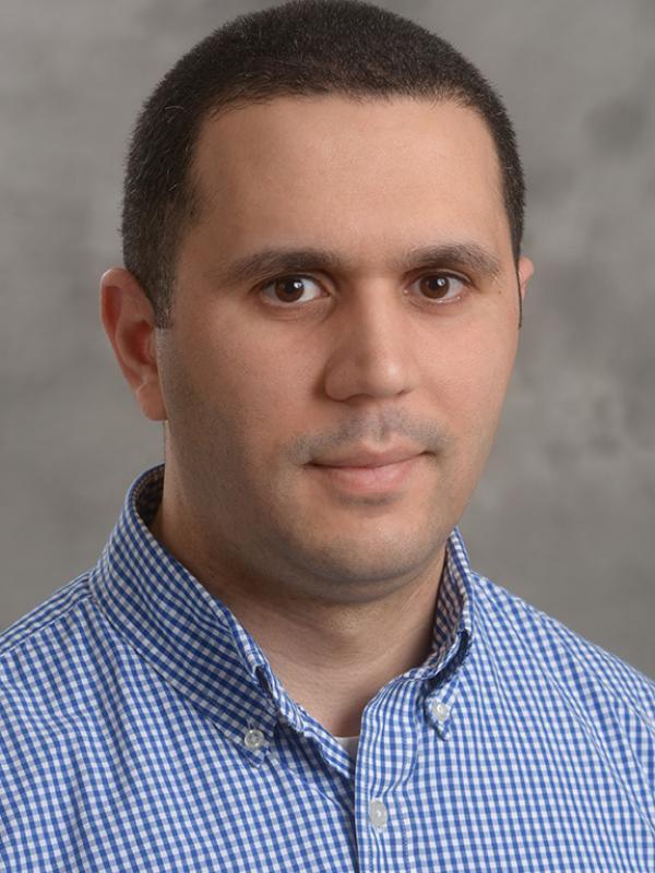 Professional headshot of Mario Bkassiny