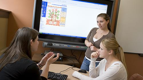 Three education students using Smartboard instruction planning
