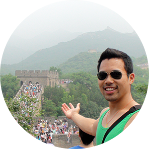 Study abroad student standing on the Great Wall of China
