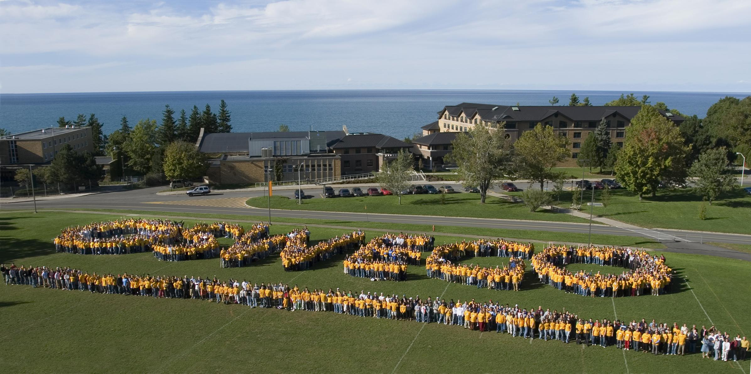Members of the SUNY Oswego family spelling out Oswego