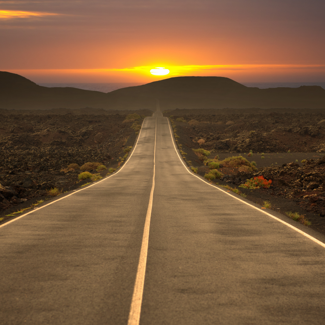 GRAPHIC: A road leading into the sunset. ACTION: What to expect when abroad guide.