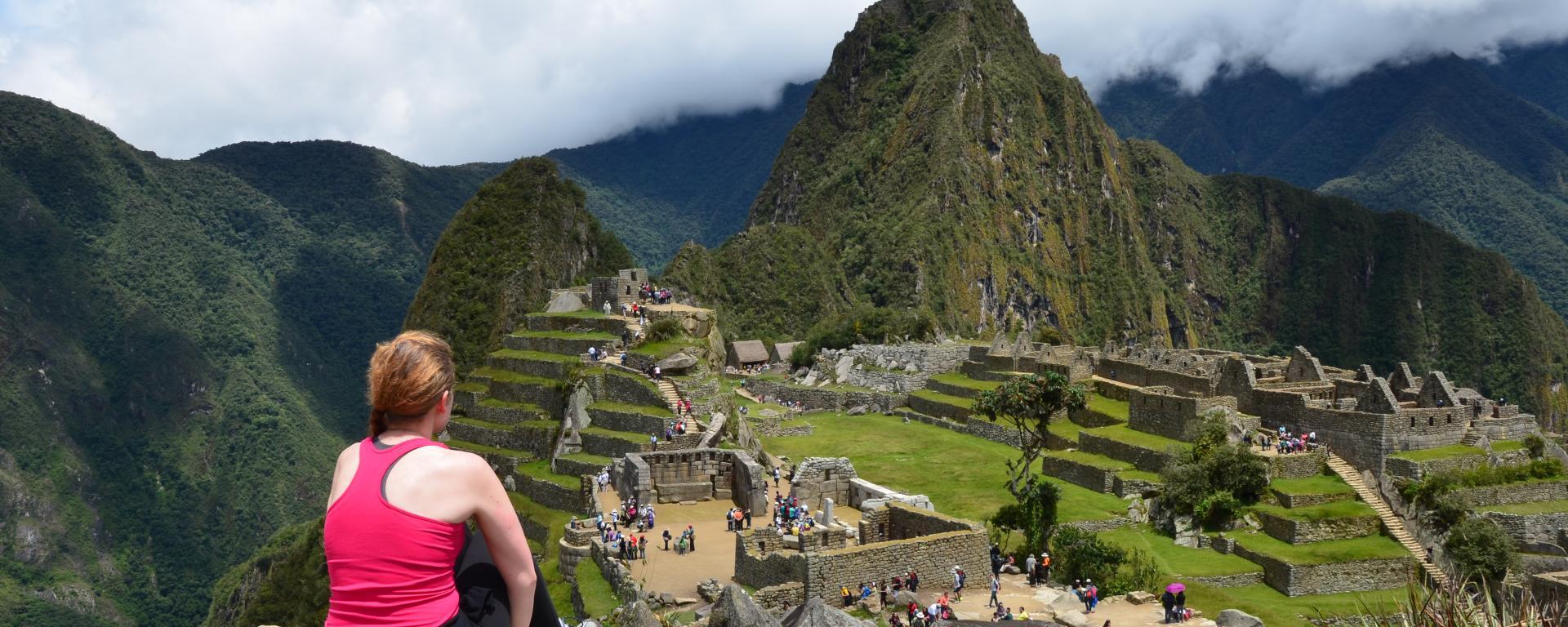 Student at the top of Macchu Picchu Peru