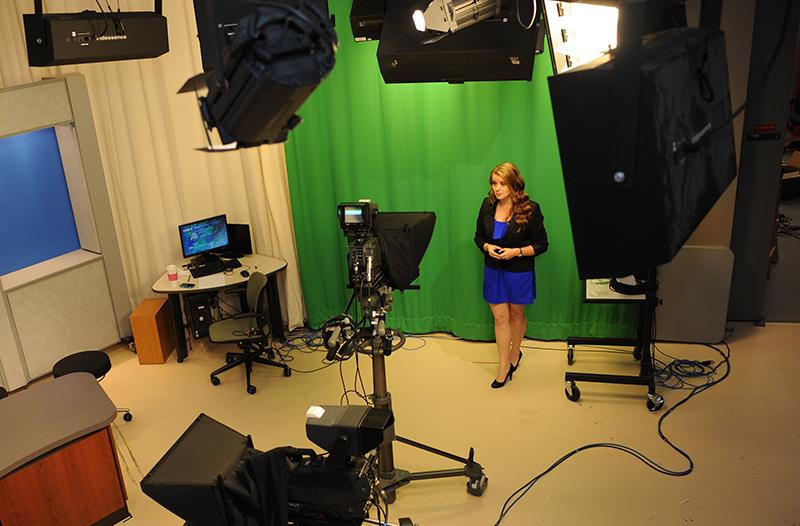 Molly Mattot doing weather forecast at WTOP on campus
