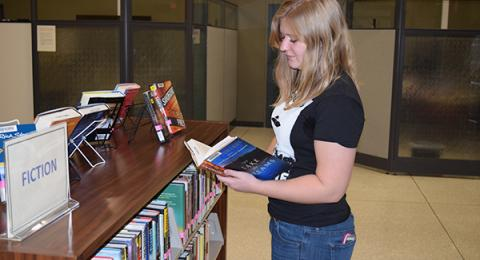 Student browsing for reading materials.