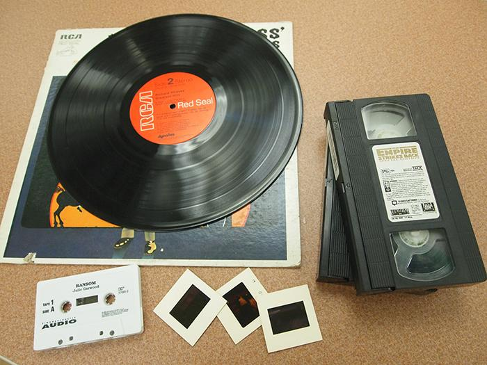Record, cassette tape, slides, and video cassettes that can be converted.