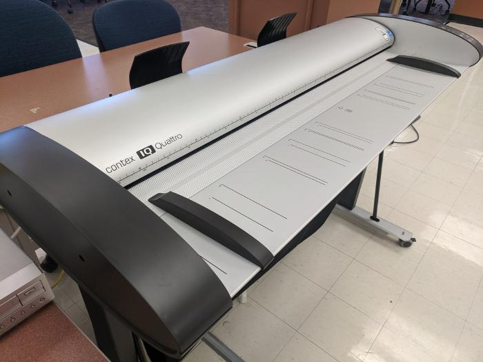 Large format scanner in the Analog to Digital Area.