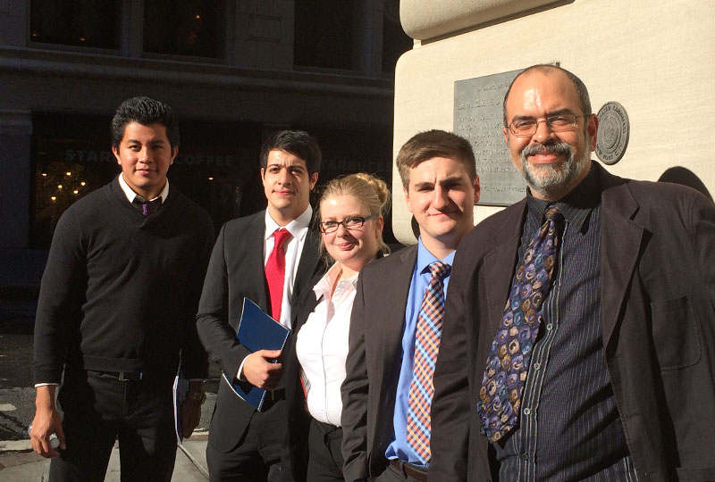 Students with professor Ranjit Dighe in New York City