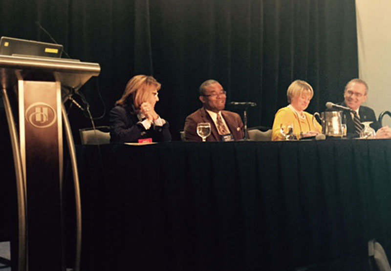 President Deborah F. Stanley with Executive Assistant Howard Gordon and other panelists