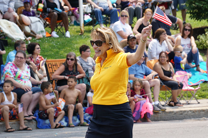 President Deborah F. Stanley serving as a grand marshal of the Oswego Independence Parade