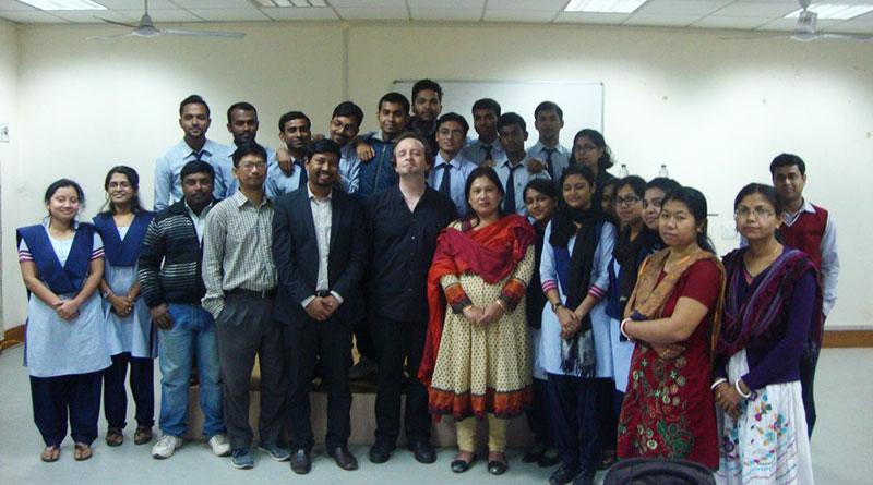 Damian Schfield with doctoral students at lecture