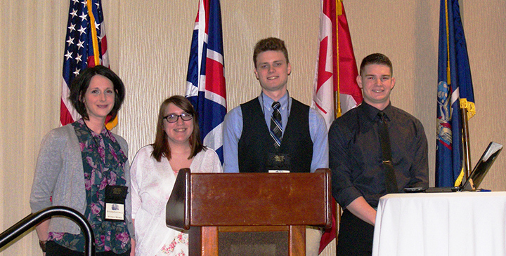 Four students who won competition at War of 1812 symposium