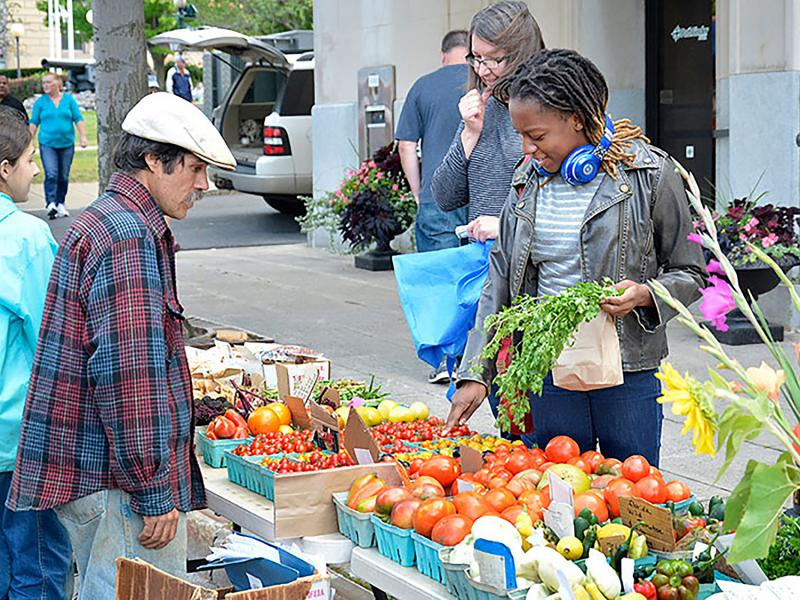 Student buys fresh goods at Farmers Market