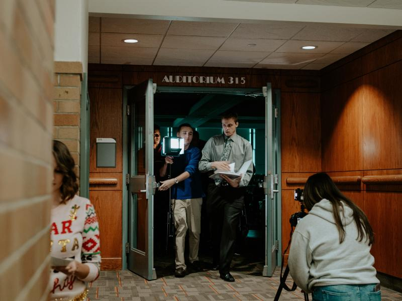 Students making holiday TV special come out of Park Hall auditorium