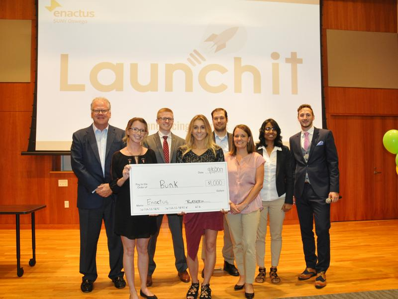 Launch It winners with judges and competition organizers