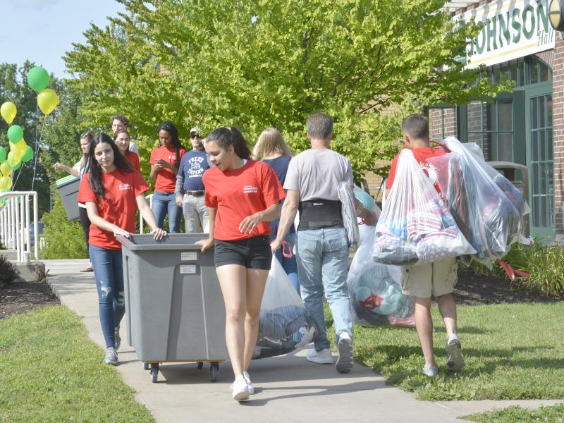 Red Carpet Crew members help move new students onto campus