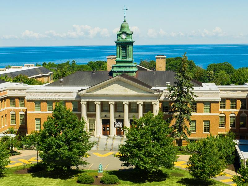 SUNY Oswego's historic Sheldon Hall on the shores of Lake Ontario