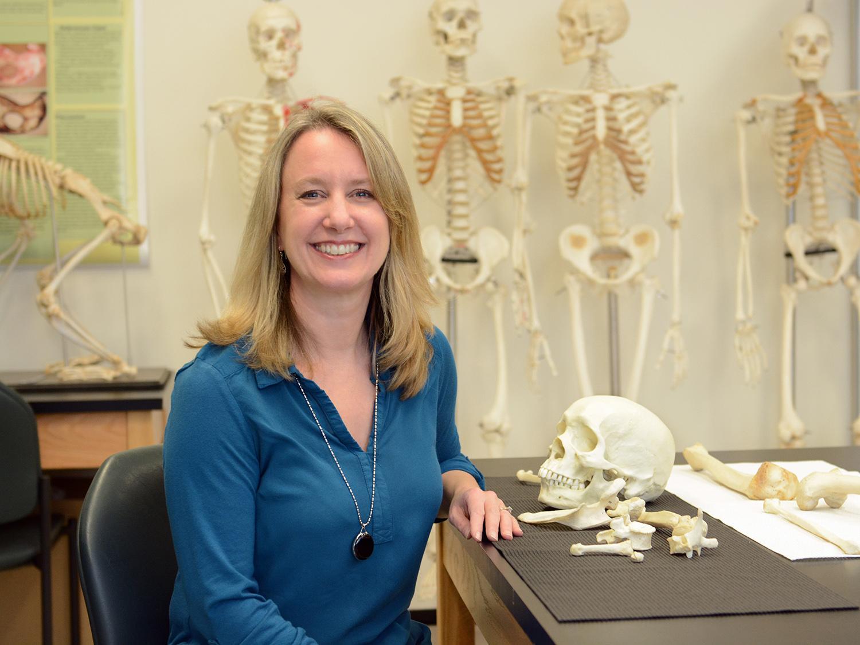 Kathleen Blake among bones