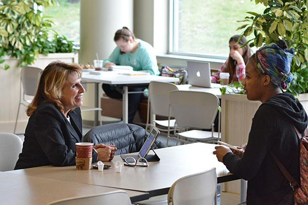 President Deborah F. Stanley meeting with students at a recently held Student Drop-In.