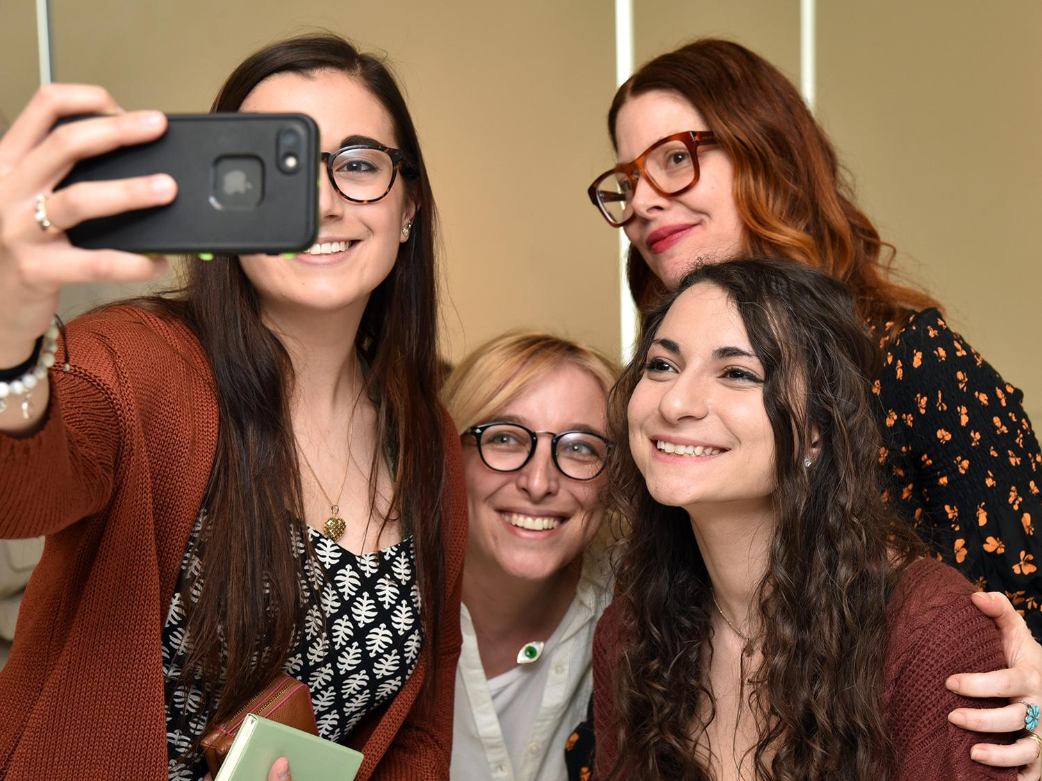 Christene Barberich, global editor-in-chief and co-founder of Refinery29, poses with art students