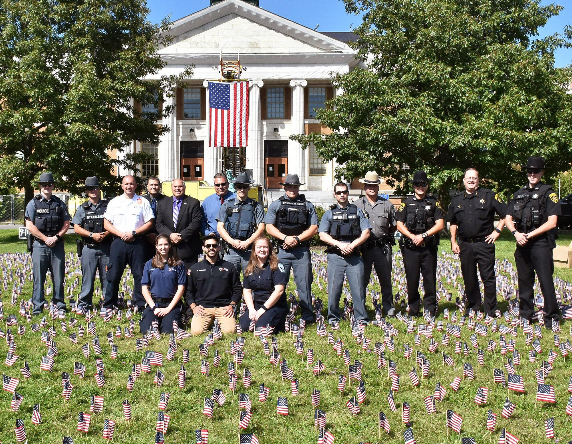 University Police and local law enforcement and first responders participated in this year's effort to plant 2,996 flags in front of Sheldon Hall to remember the lives lost in the Sept. 11, 2001 terrorist attacks.