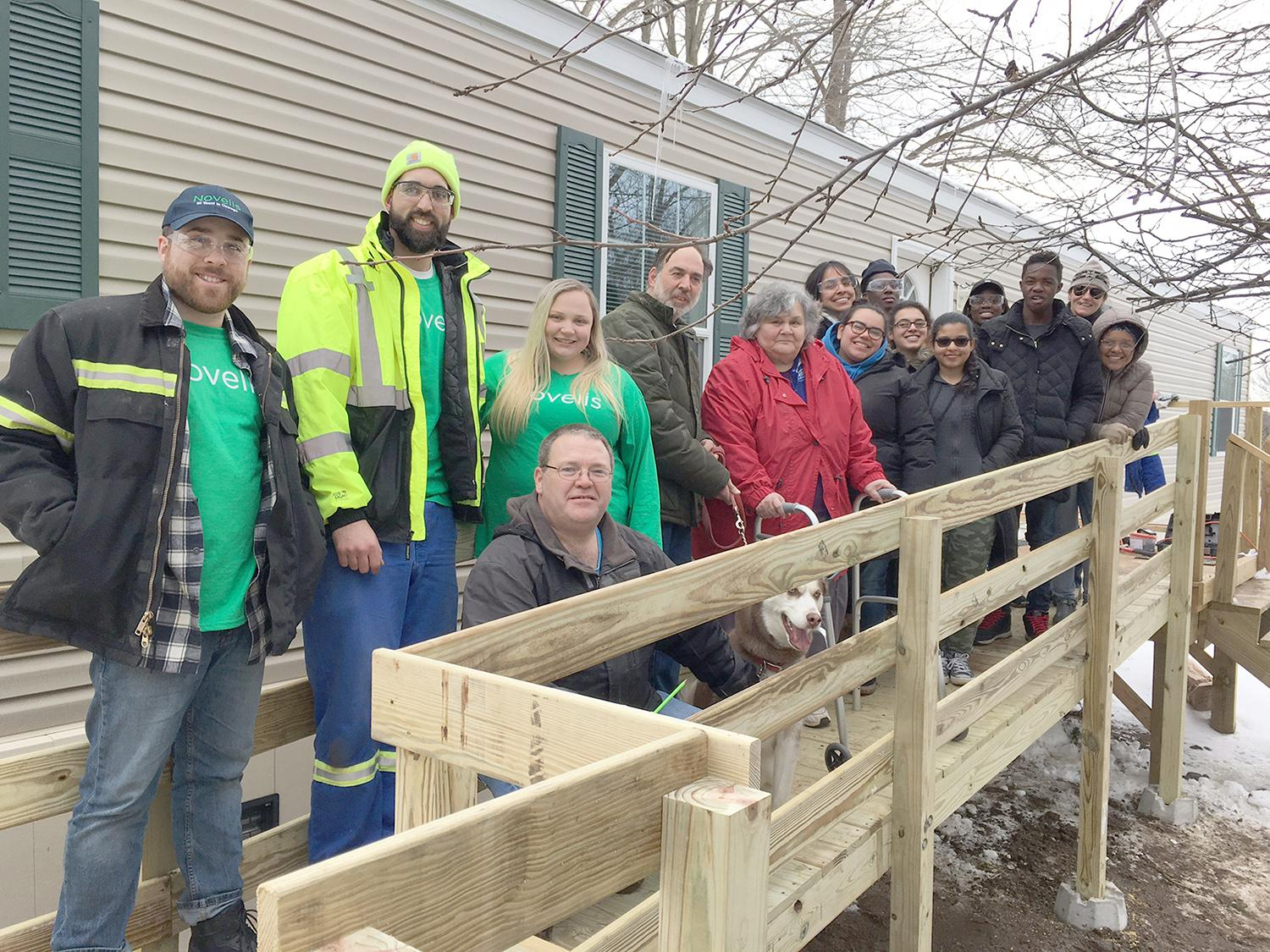 Students work with Novelis employees to build ramps for ARISE