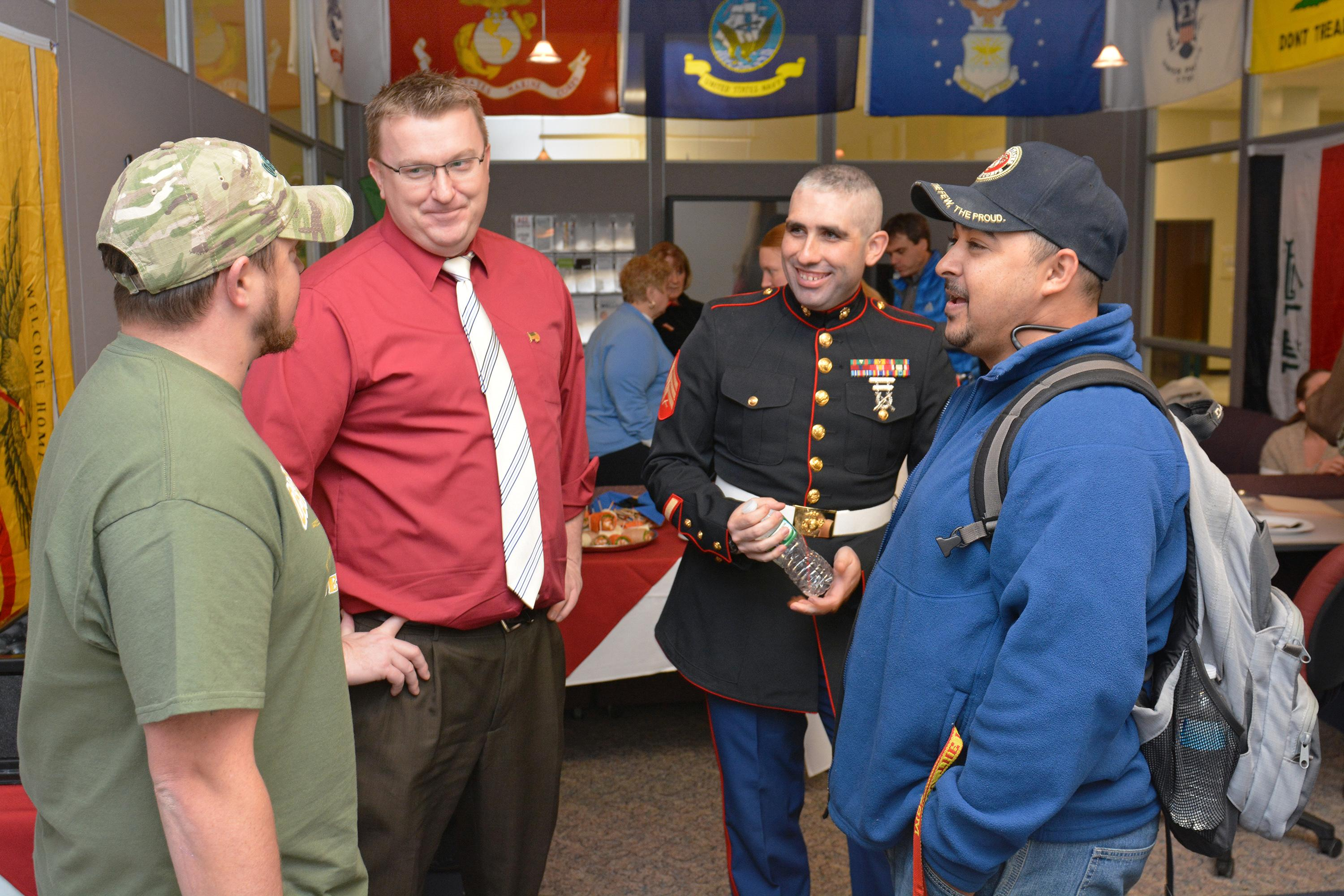 Ben Parker (second from left), coordinator of veteran and military services, speaks with student veterans at a Veterans Day open house.