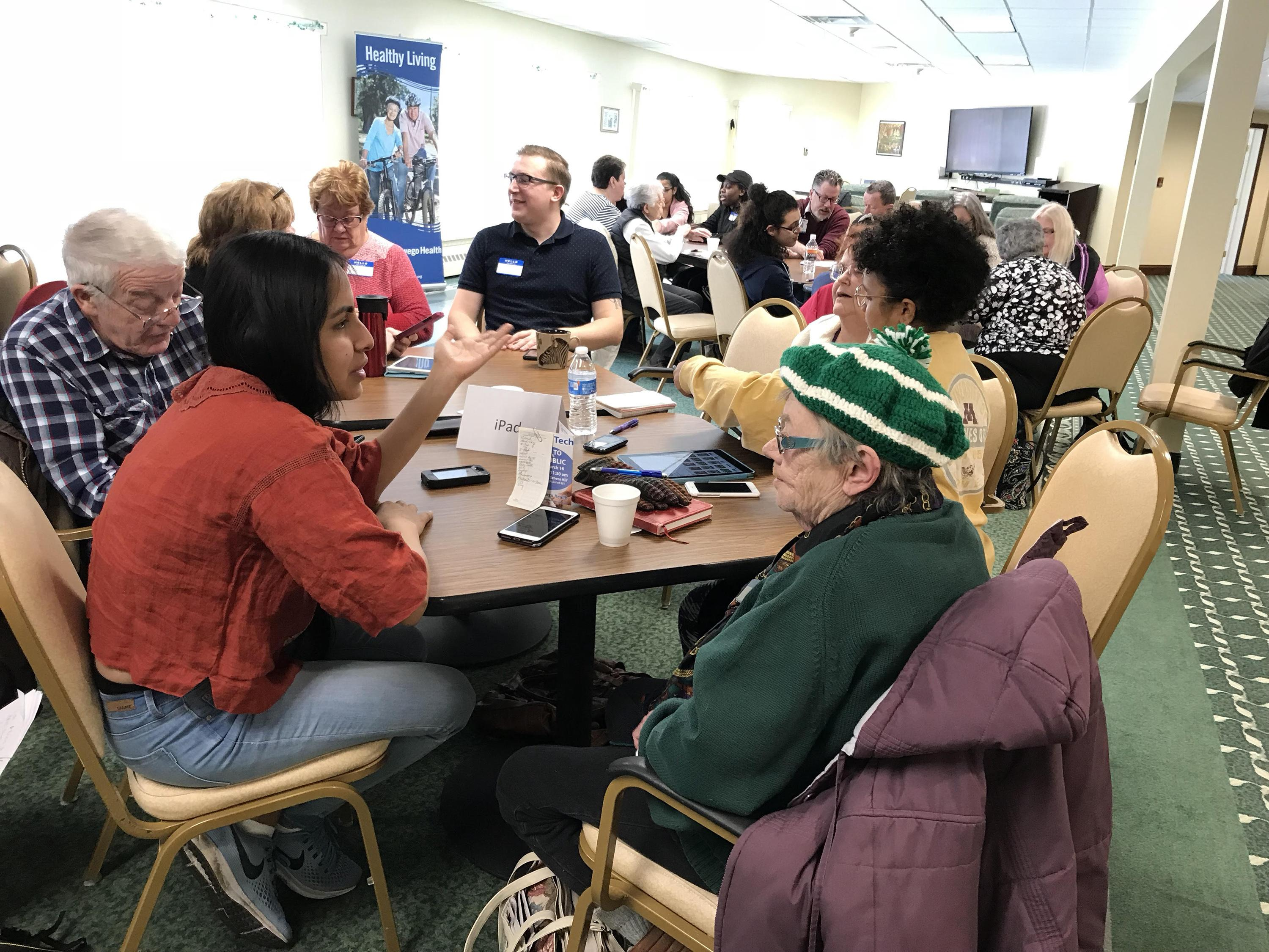 Students participate in a local community outreach effort to spend time with senior citizens at Springside at Seneca Hill and help them become more technically savvy