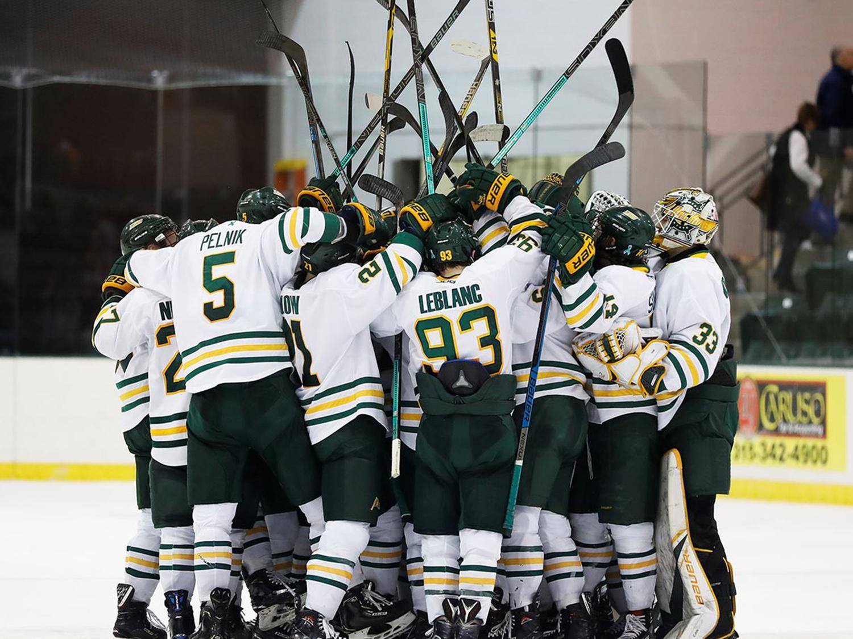 Laker men's hockey players celebrate a win