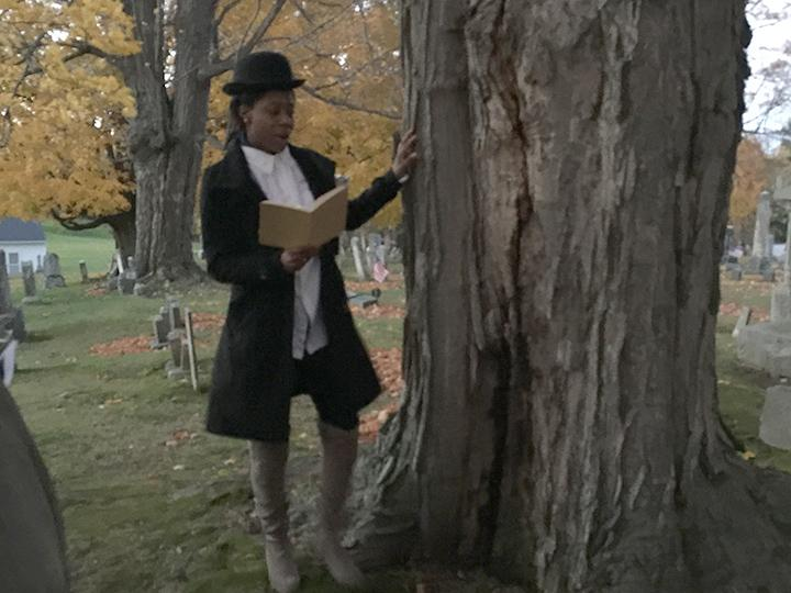 A student dressed in historical clothing telling a story