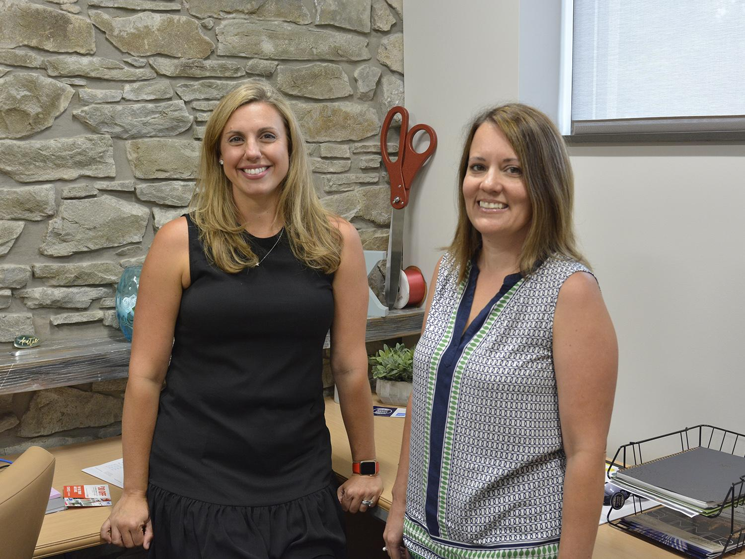 Katie Toomey (left), executive director of the Greater Oswego-Fulton Chamber of Commerce, and Chena Tucker, director of the SUNY Oswego Office of Business and Community Relations.