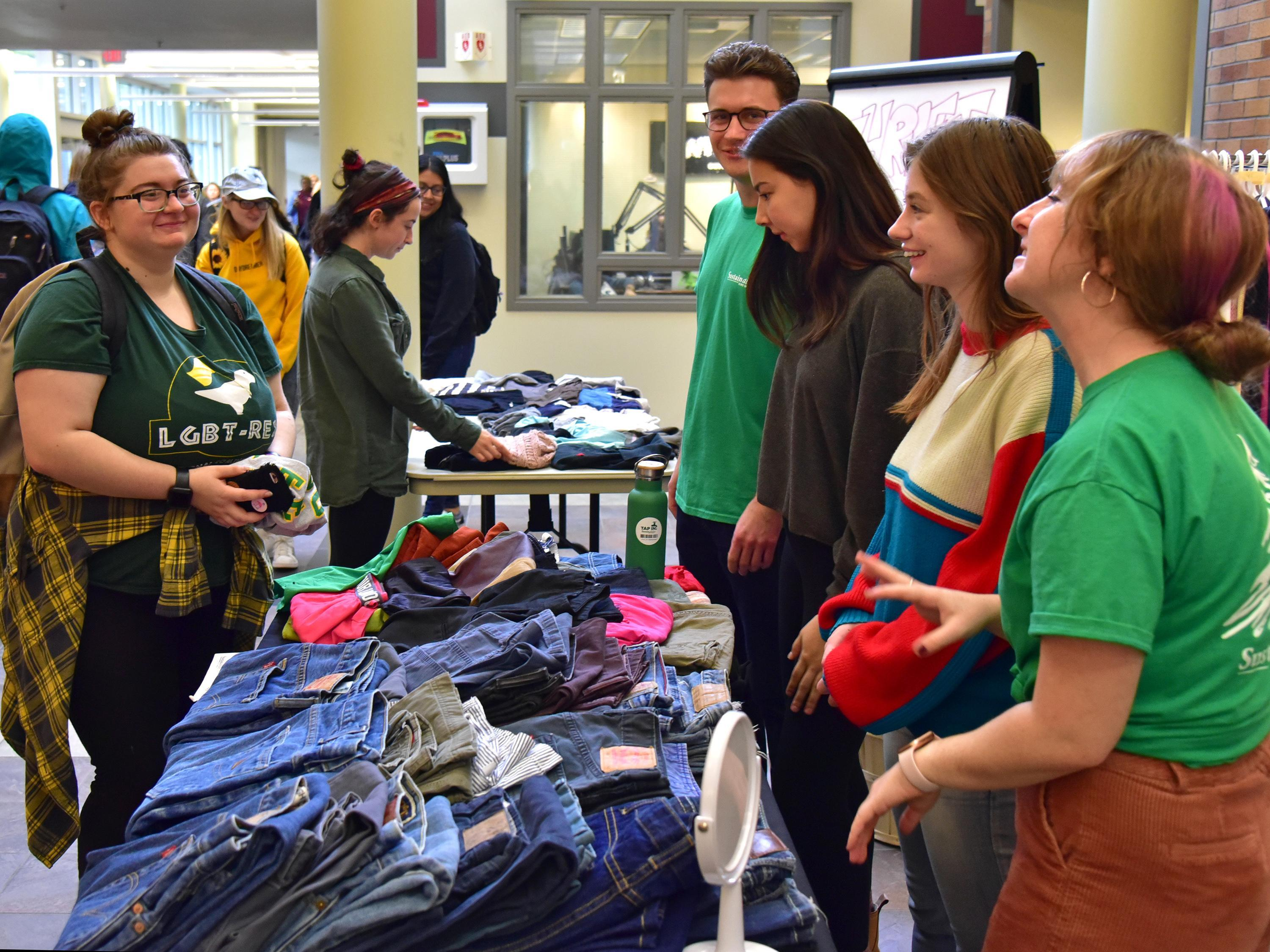 Students buying and working the table for a thrift sale